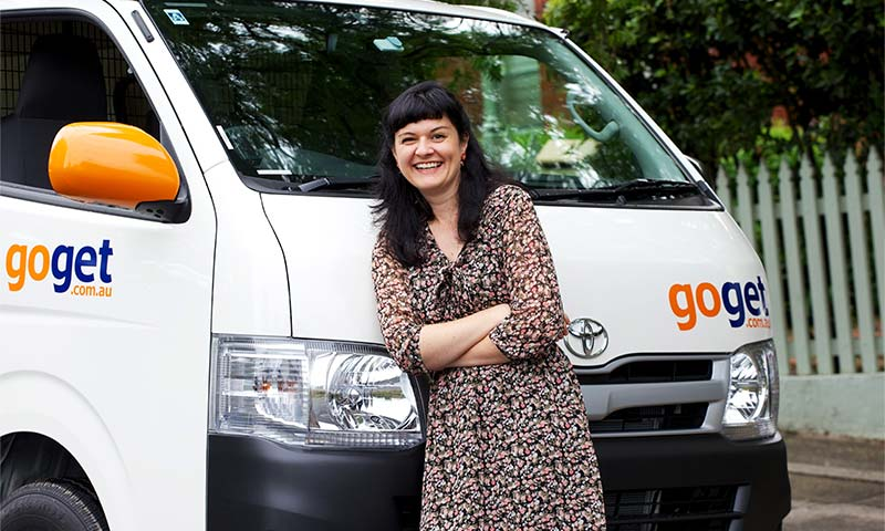 A GoGet customer joyed with the van rental she's about to make