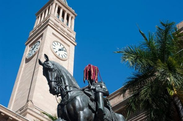 The Brisbane City Hall Clock Tower rises above a statue of a man on a horse, who is wearing a maroon state of origin wig. As well as being the centre of the city, the Museum of Brisbane runs free tours of the clock tower over the school holidays.