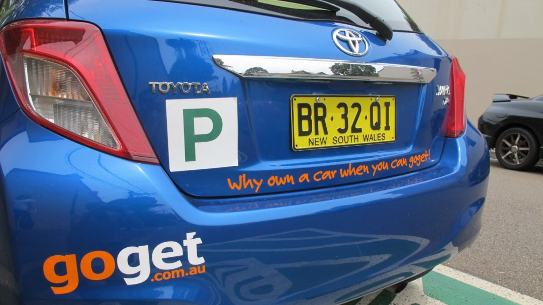 A blue GoGet car with a Green p plate on it - GoGet is a great alternative to car rental for p platers