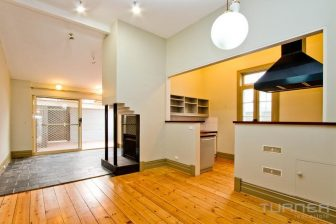 The open plan living room and kitchen of a $500 per week rental property in Adelaide.
