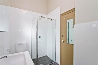 A white walled, modern bathroom features in this $500 per week rental property in Adelaide