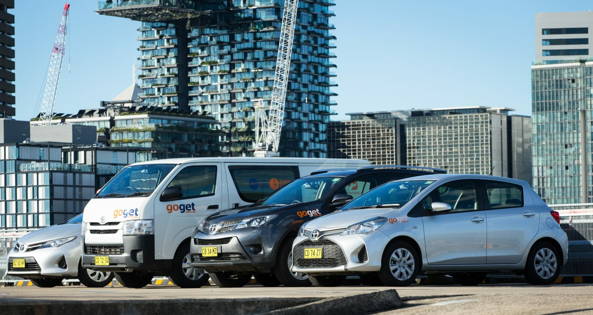 A lineup of GoGet cars in the Sydney CBD - goget has a range of vehicles for hire like vans, suvs, and hatchbacks
