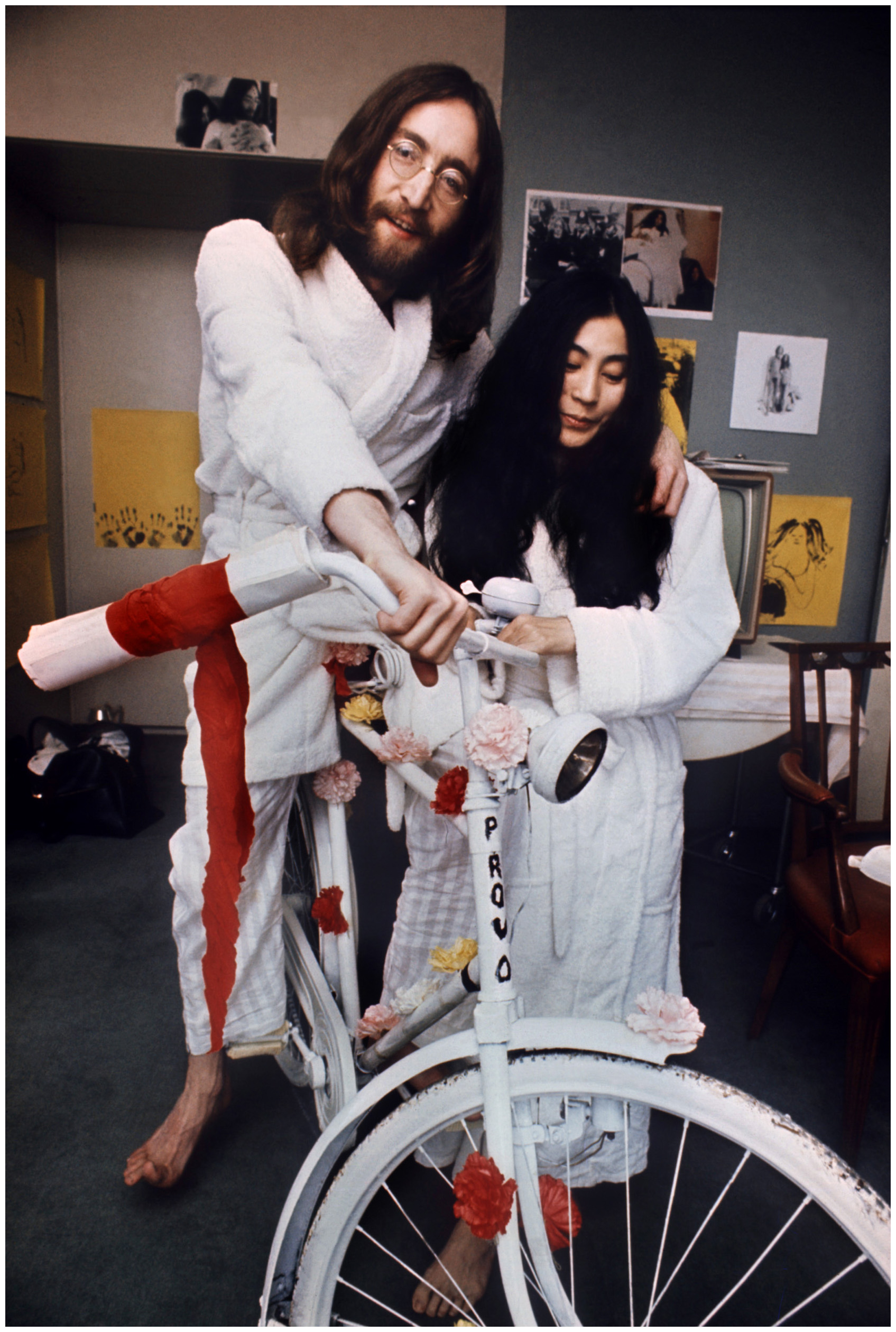 John Lennon and Yoko Ono with on of the earliest share bikes, the white bicycles, during their famous bed in protest in Amsterdam in March 1969 - John and Yoko area a surprising part of the history of car sharing