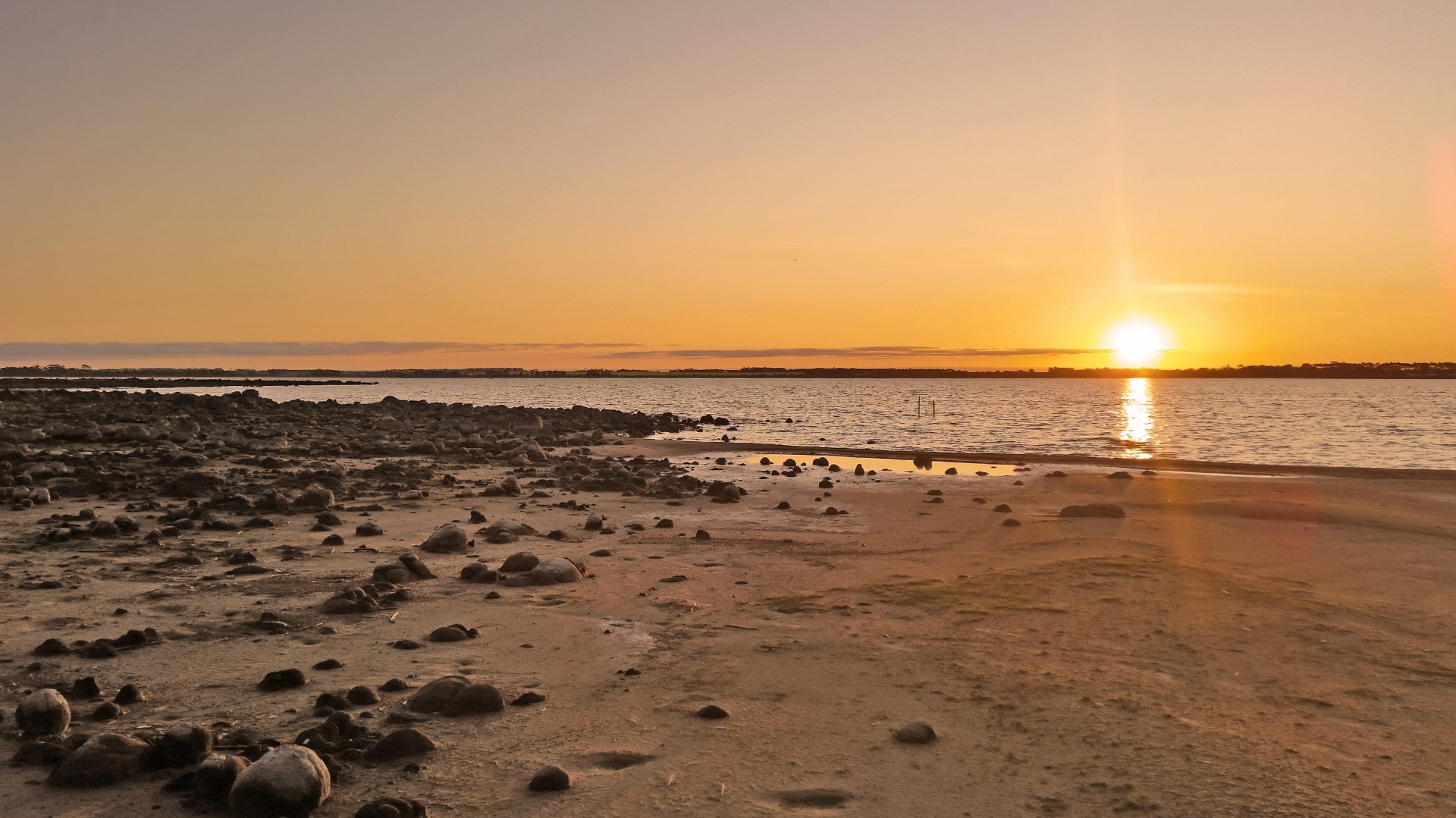 Sunset over Lake Bolac in Victoria where there are lots of dog friendly camping Victoria