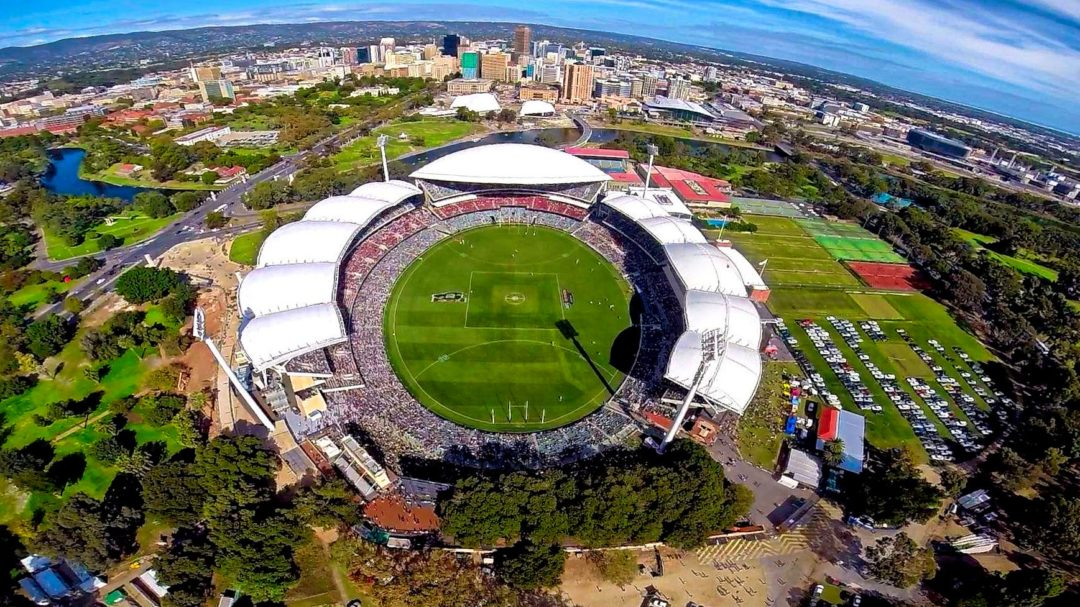An aerial shot of Adelaide oval, with the horizon warped by a fish eye lens