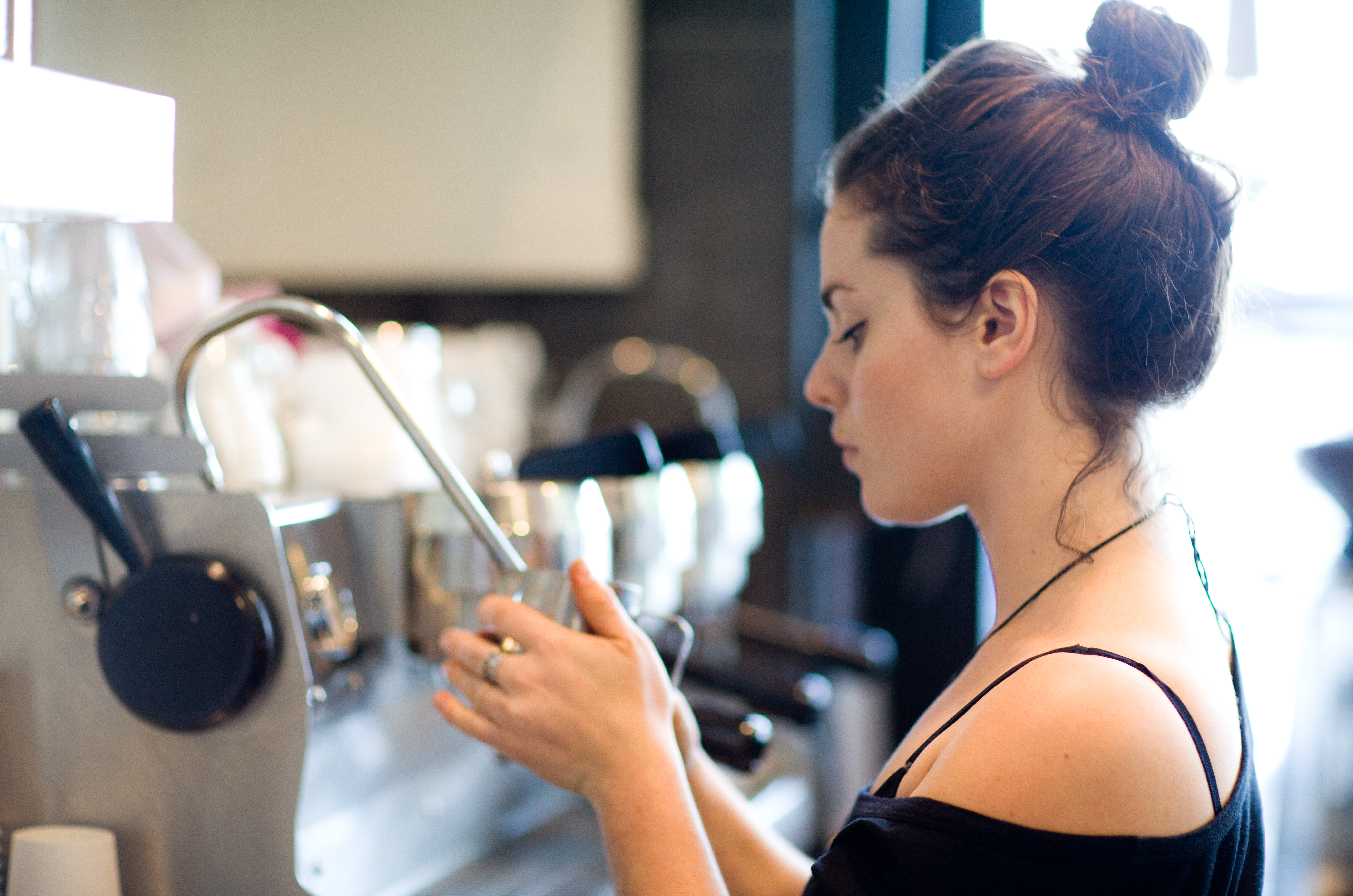 A female barista making coffee in one of Melbourne's best cafes, Fitzrovia