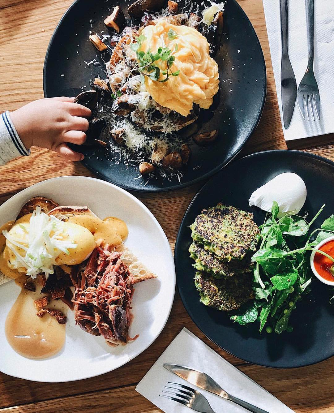 A top view of three meals at the Reunion & Co cafe in Melbourne, one of the best in town as voted by GoGet members