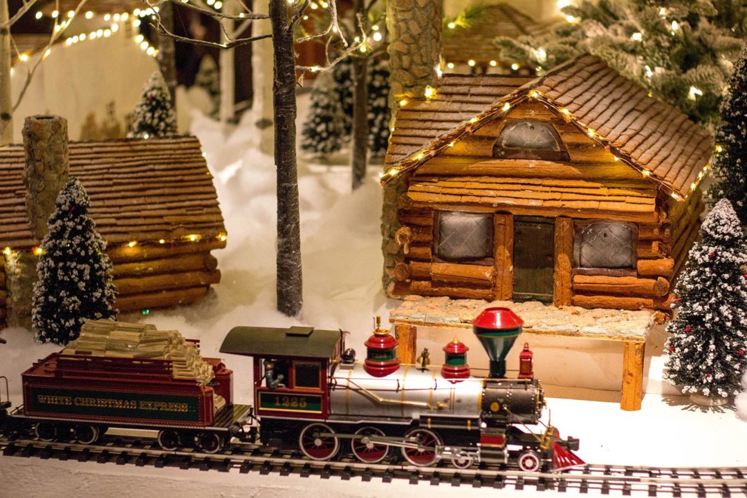 A toy train on a Christmas set, illustrating that we can get the train at Christmas, not drive