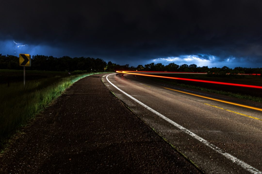 A car driving on country roads at night - long exposure