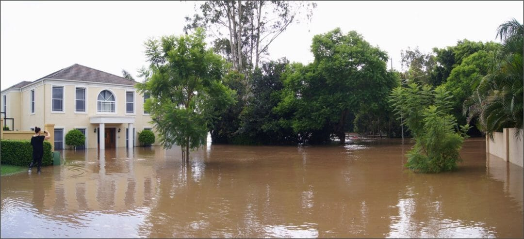 A house and road in deep flood water in Brisbane, making it impossible to drive in a storm that cause this