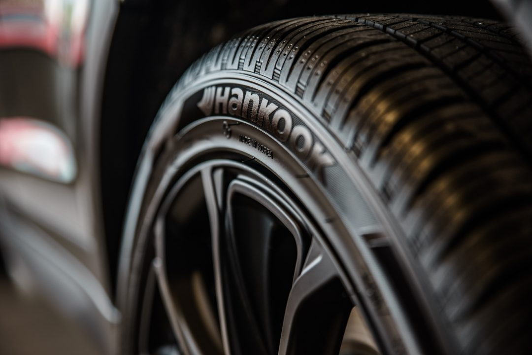 Close up of fully inflated car tyres, which are the key to fuel efficient driving