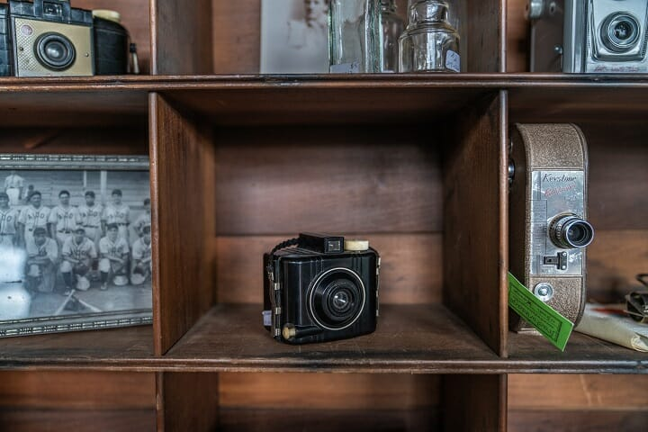 An antique camera on a shelf