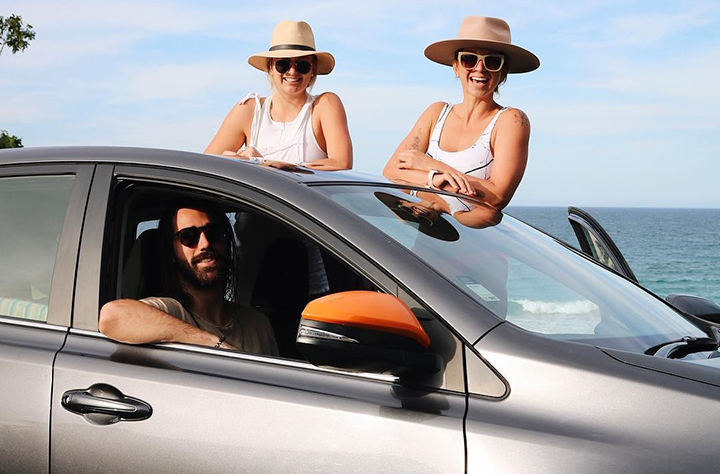 Friends at the beach in a GoGet - Car sharing: What Is It & How Can You Benefit?