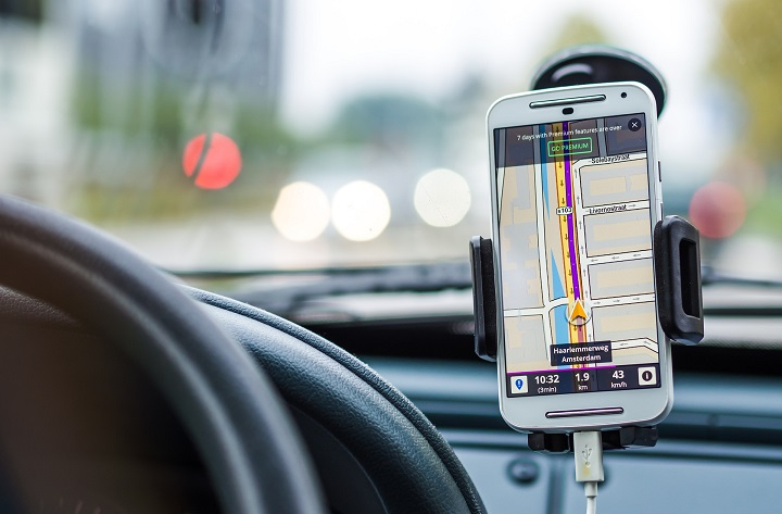 A mobile phone in a cradle, the correct way to use a phone without breaking the road rules