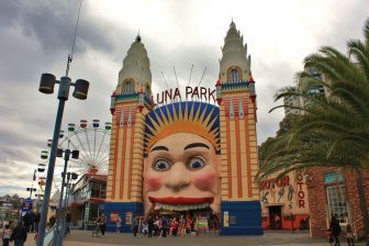 Sydney's Luna Park Face on a cloudy day. The park is a good place to find Free Wifi in Sydney